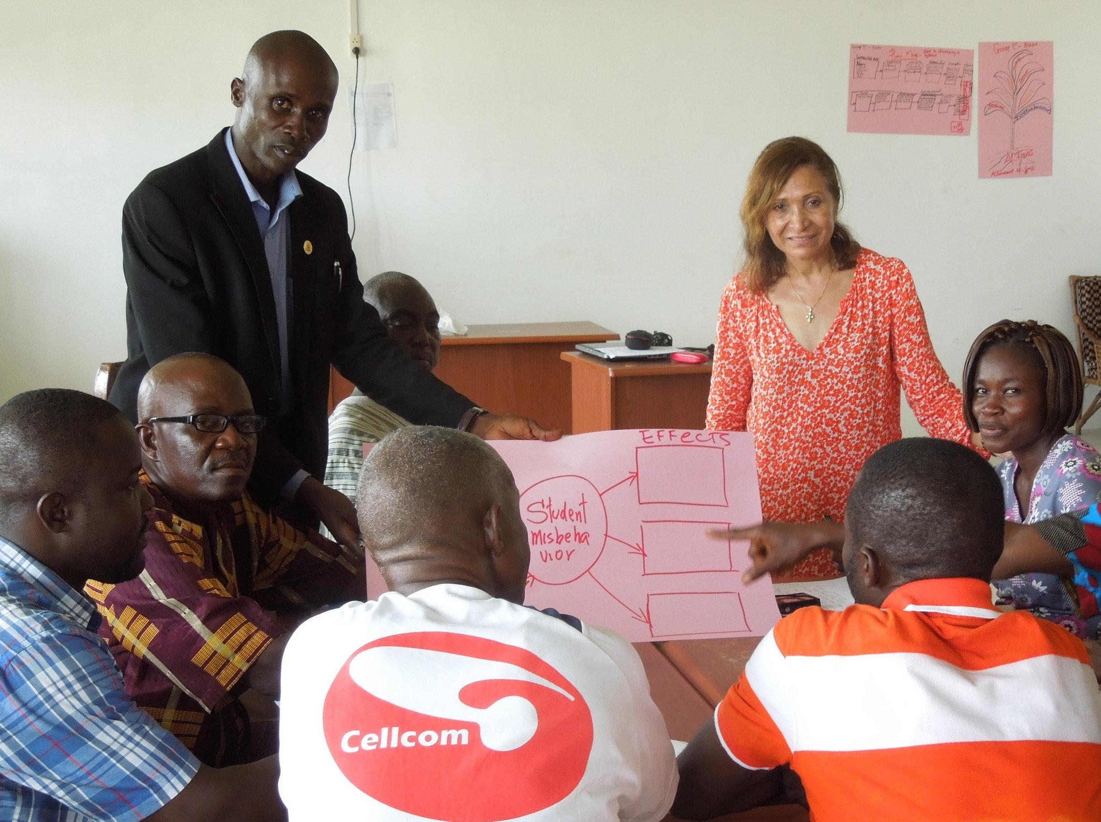 Gil-Garcia conducting a teacher training at Grand Bassa Community College, Liberia.