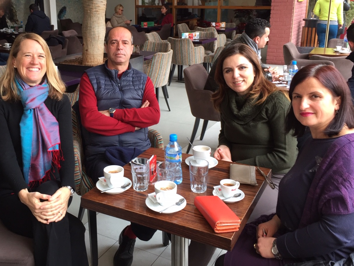 Sentell (at left) enjoys a coffee break with colleagues in Tirana