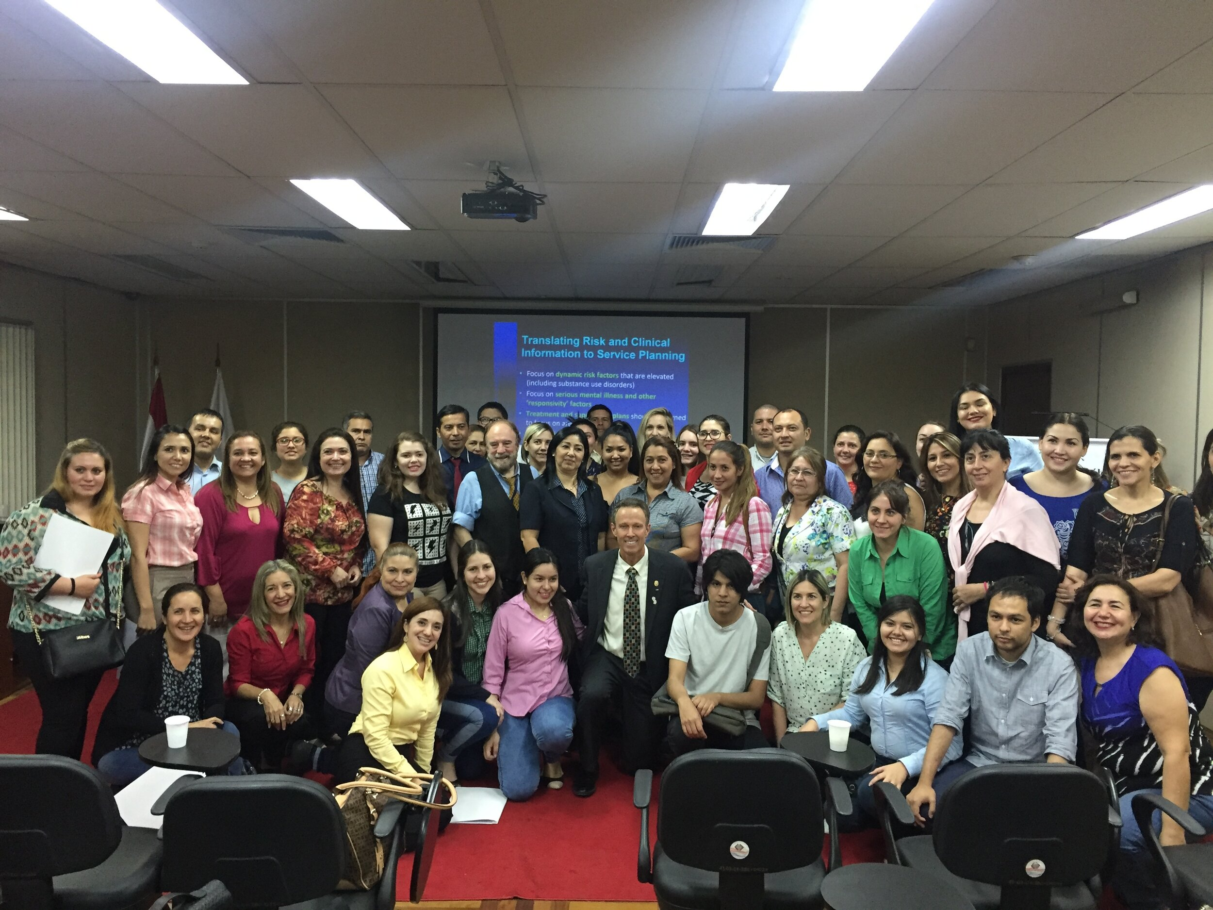 Peters (first row, center) poses with participants after a successful workshop.