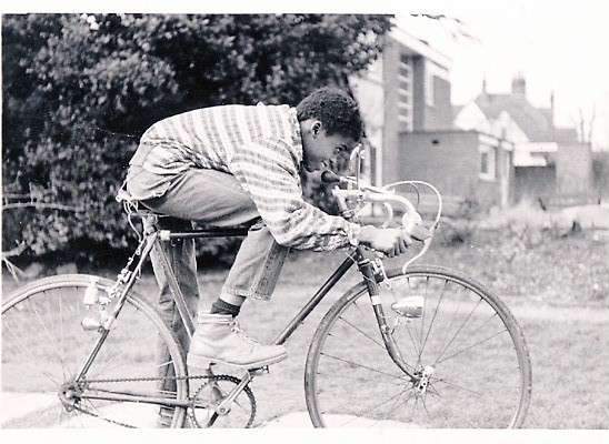Kriss in the summer of 1972 in the children home with his first bike built by Uncle Martin.