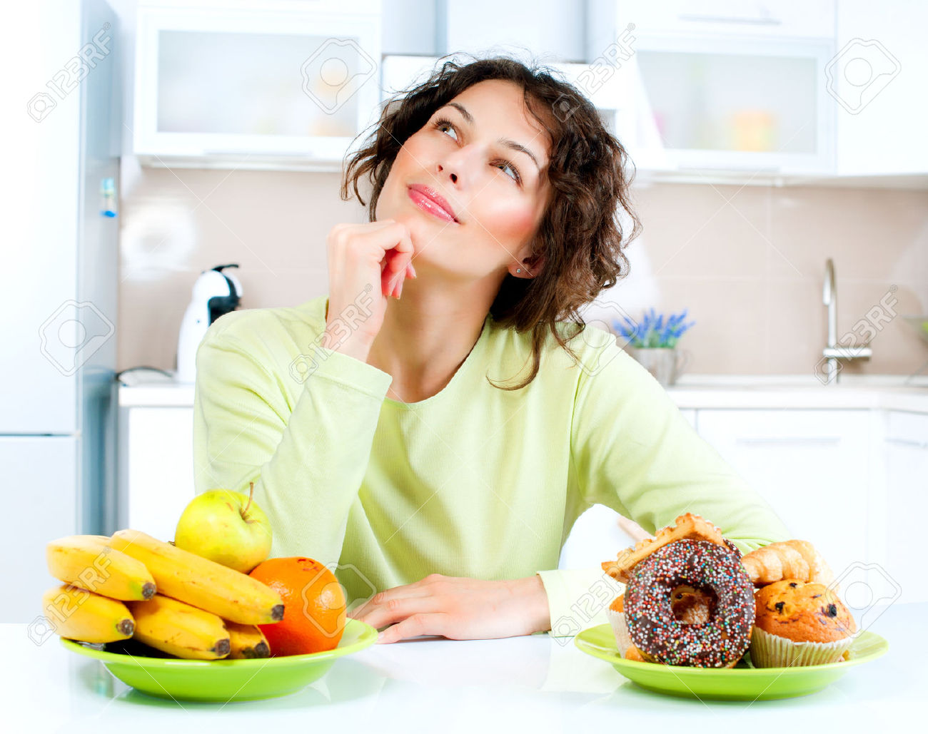 23736090-Dieting-concept-Young-Woman-choosing-between-Fruits-and-Sweets-Stock-Photo.jpg