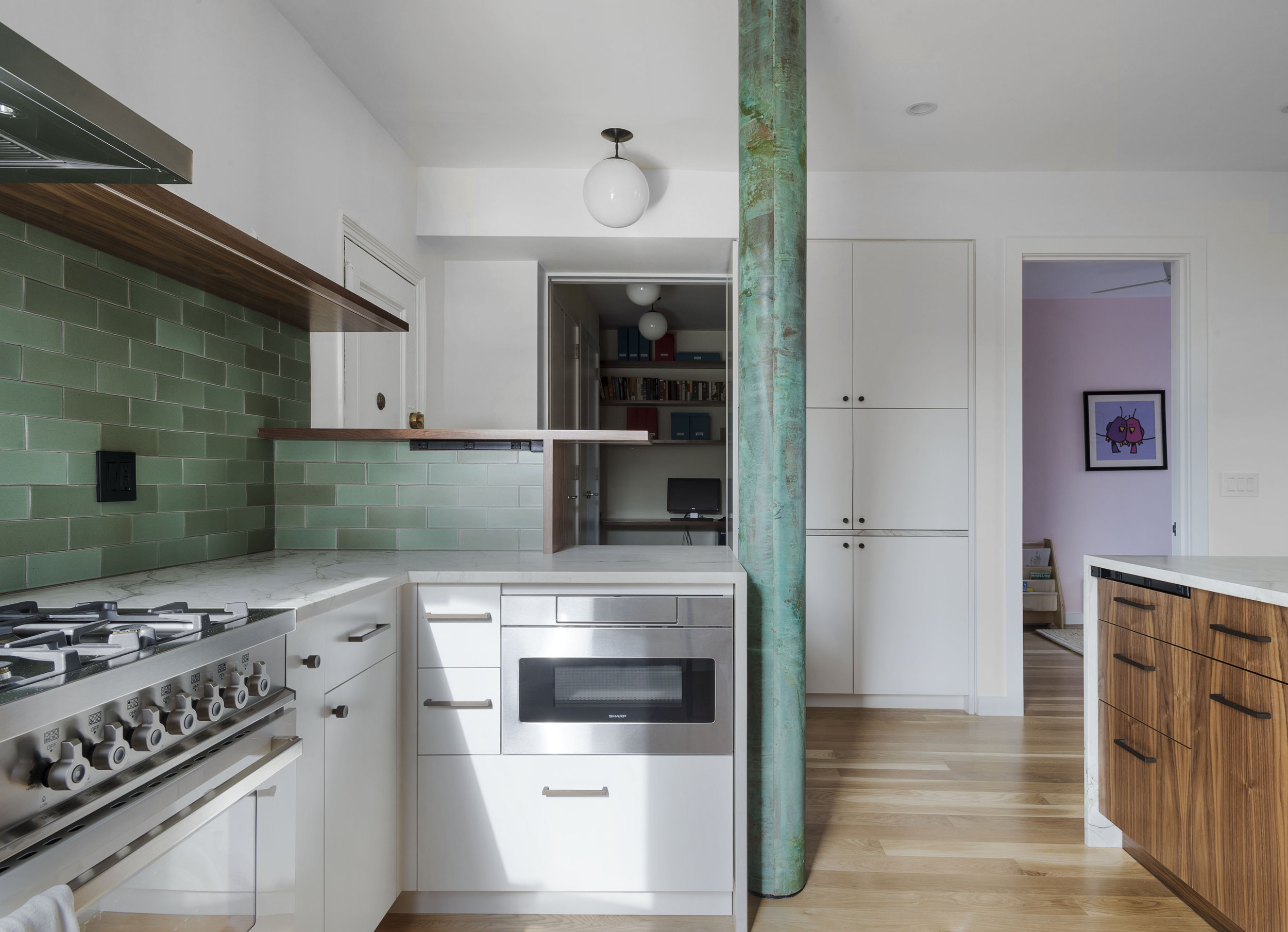 Patina  This apartment, in a landmarked, Art Deco building, in Park Slope, features a color palette inspired by the copper-wrapped storm drain, in the kitchen. This planning obstacle was transformed into an opportunity for a unique design feature of the apartment.