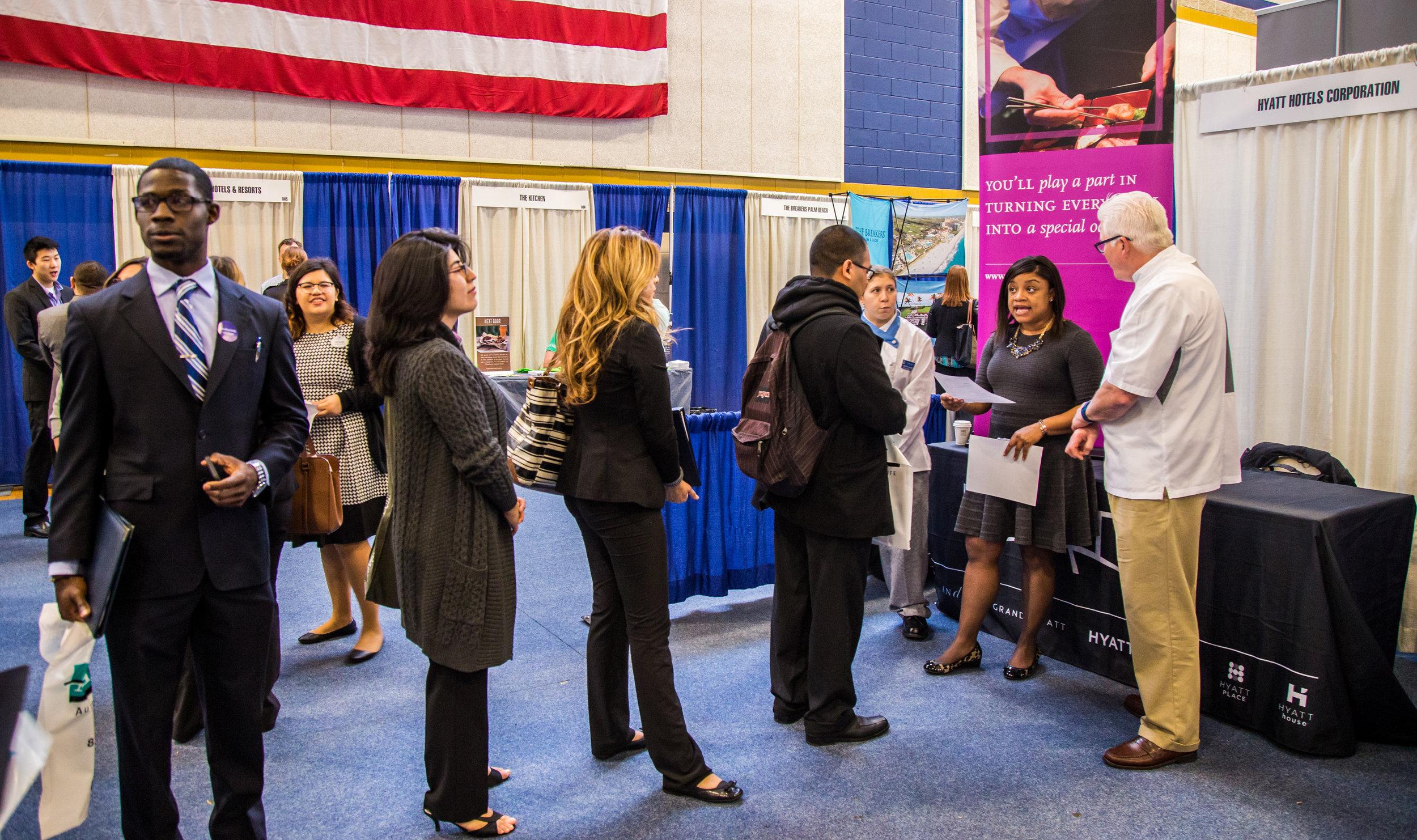 JWU students speak to Hyatt employees at a career fair.