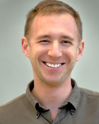 Adam Kaufman Headshot.jpg