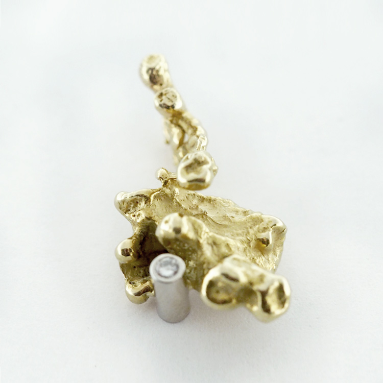 <b>Gold Nugget<br>Charm</b><br>$1,043<br>14K Yellow Gold, <br>1 Brilliant Cut Diamond