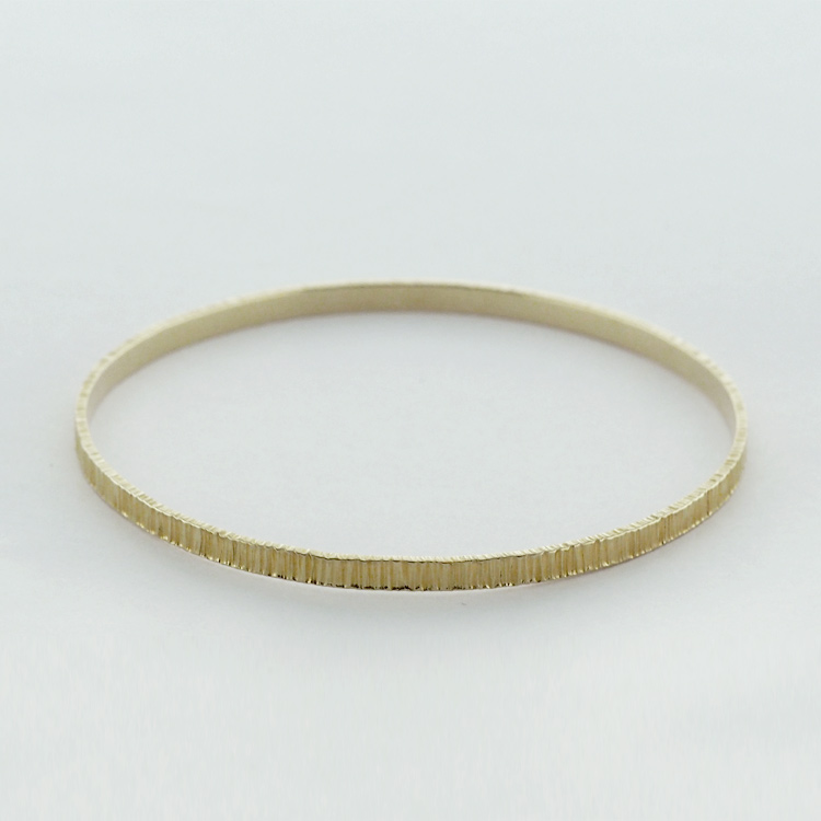 <b>Gold Bangle</b><br>$2,249<br>18K Yellow Gold