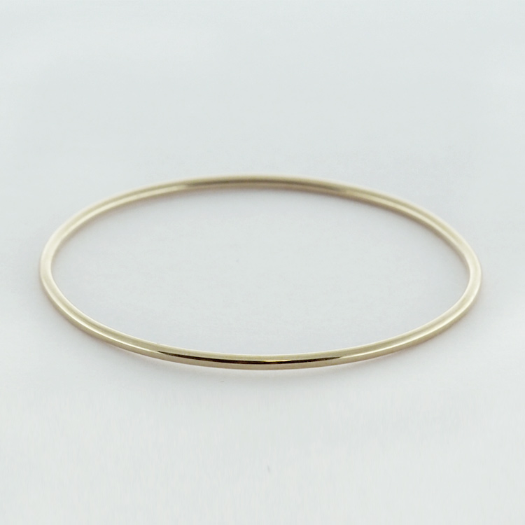 <b>Gold Bangle</b><br>$1,628<br>14K Yellow Gold