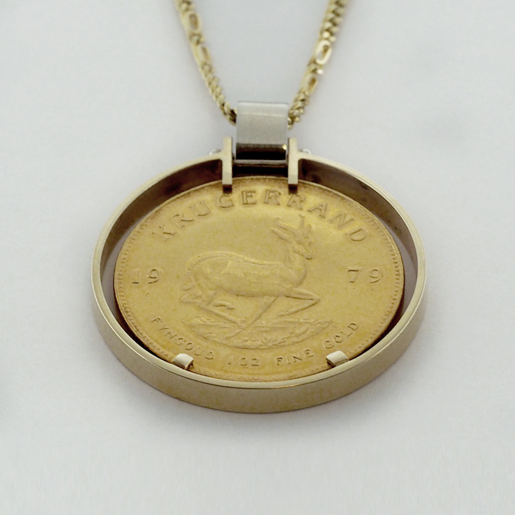 <b>1979 Coin Pendant</b><br>$1,987<br>14K Yellow Gold<br>19K White Gold<br>Chain and Coin<Br>Extra