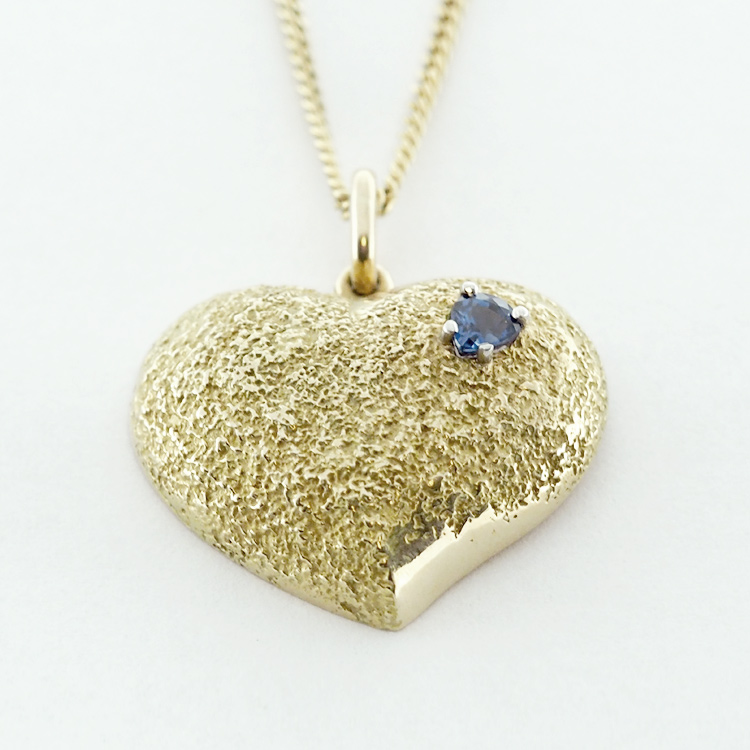 <b>Love Pendant</b><br>$1,819<br>14K Yellow Gold<Br>Pear Shaped Blue<br>Sapphire 0.36 ct