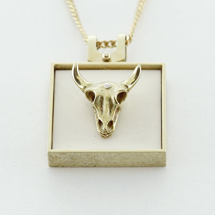 <b>Skull Pendant</b><br>reg.RT: $3,887/Special: $2,550<br>14K Yellow Gold,<br> Gold Skull on Ivory