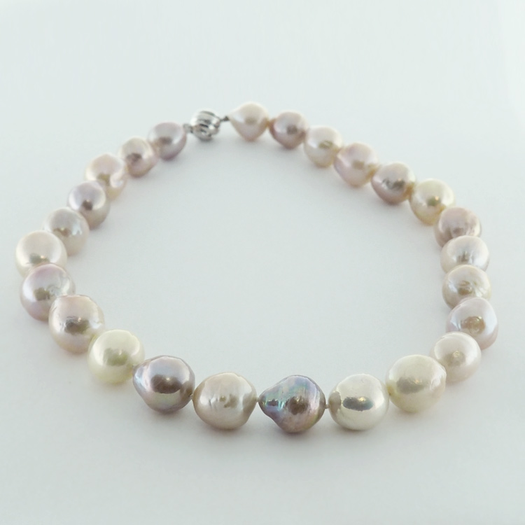<b>Baroque Pearls</b><br>$1,385<br>Large Baroque<Br> Fresh Water Pearls