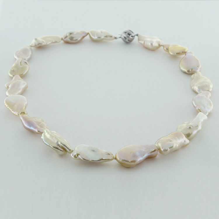 <b>Natural Colour</b><br>$975<br>Natural Shape and<br> Colour, Fresh<br> Water Pearls
