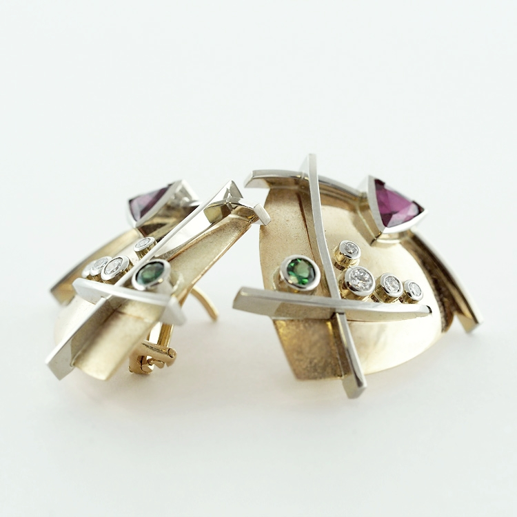 <b>Ruby and Tsavorite Garnet</b><br> $6,375<br> 14K Yellow Gold,<br>19K White Gold,<Br> Ruby, Tsavorite<br>Garnet and 4<br>Diamonds