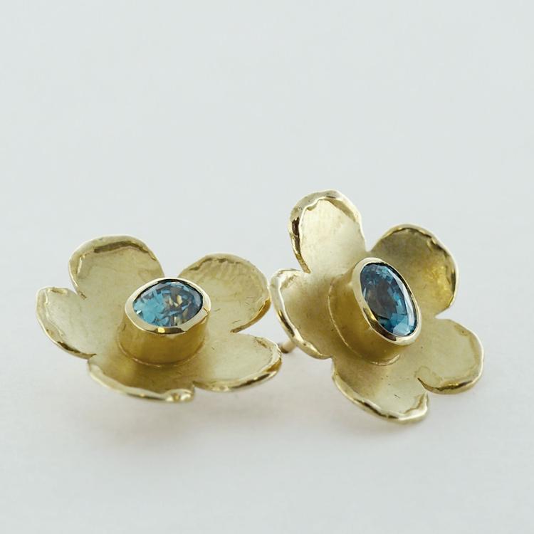 <b>Wild Rose</b><br>reg.RT: $3,548/Special: $2,661<br>18K Yellow Gold, <br>2 Blue Zircons: TW: 3.55 ct<br>Handcrafted Designer Series