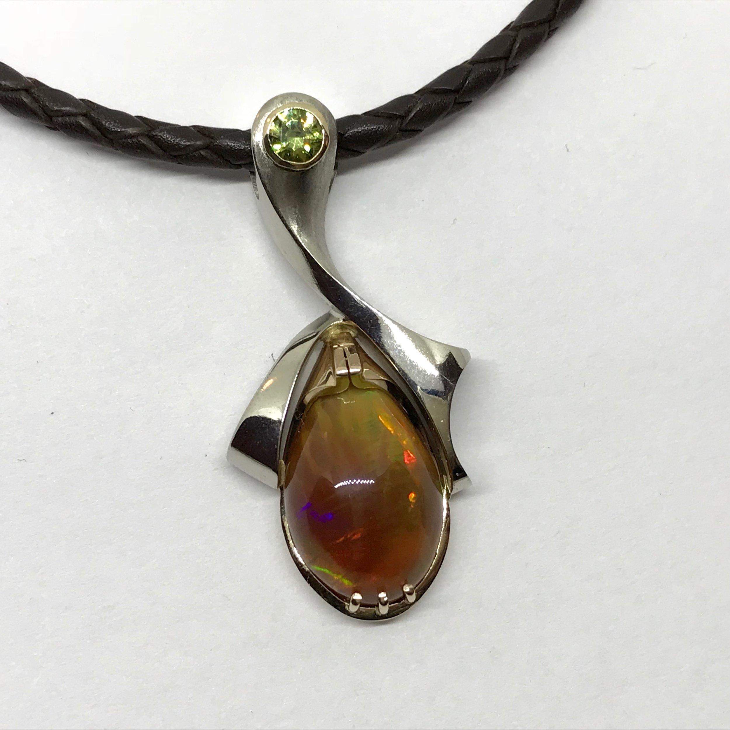 NEW ITEM <br><b>Fire Opal Pendant</b><br>reg.RT: $4,285/Special: $3,642<br>14K White Gold<br>7.61ct Fire Opal<br>0.324ct Demantoid Garnet<br>Designer Series