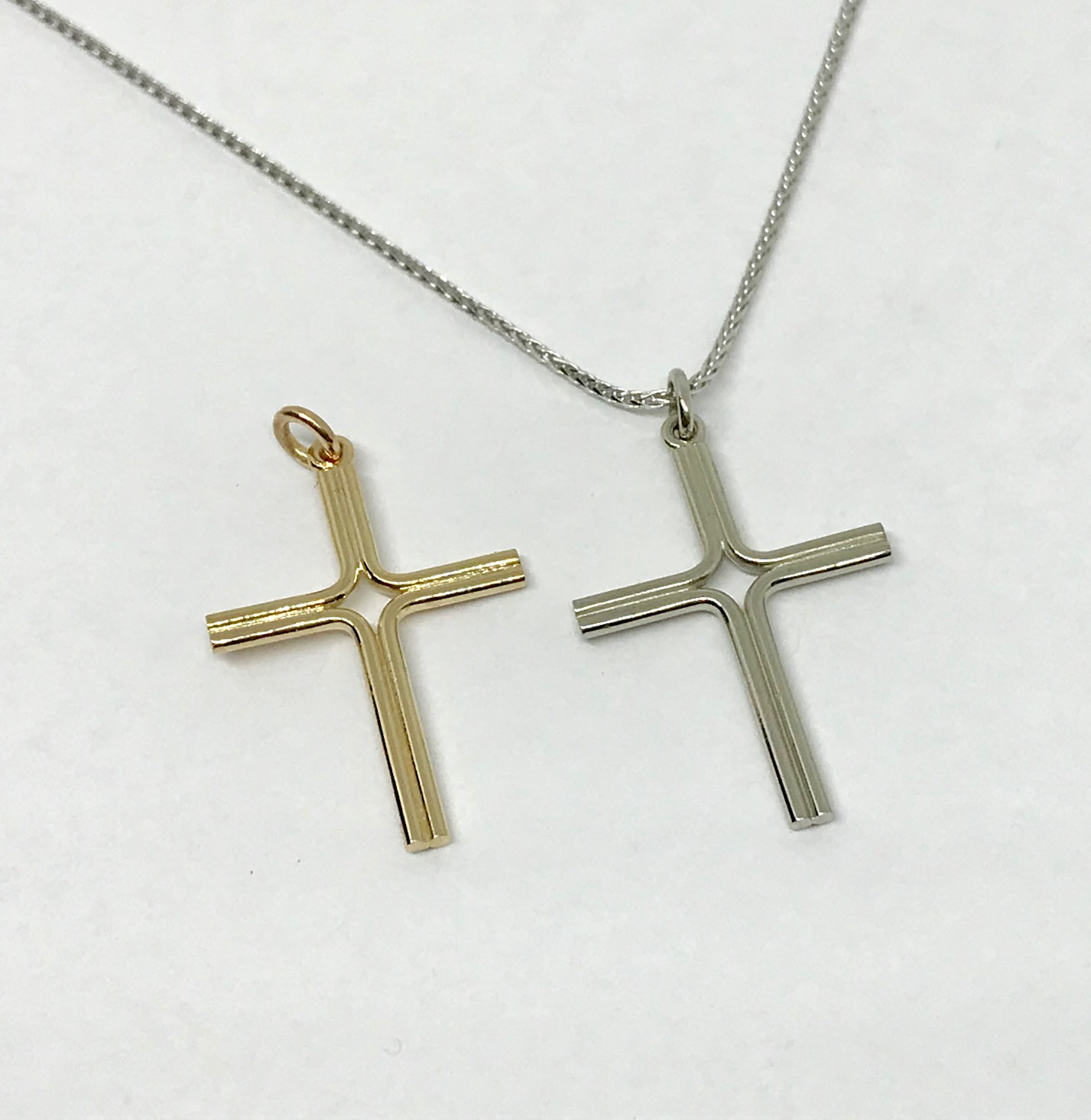 <b>Gold Crosses</b><br>$397ea.<br>14K Yellow or White Gold<br>Designer Series