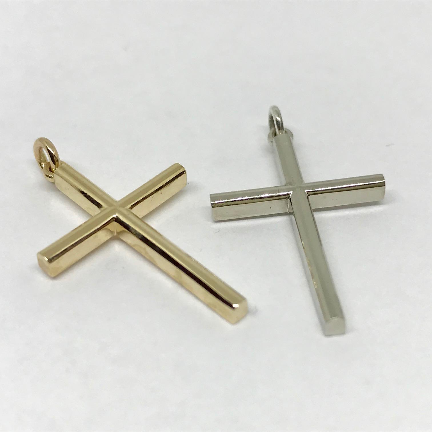 <b>Solid Gold Crosses</b><br>reg.RT: $583ea./Promotion:$466<br>14K Yellow or White Gold<br>Designer Series