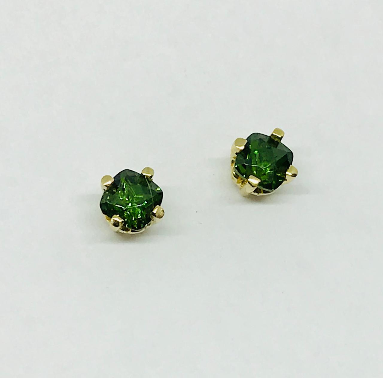 <b>Green Zircons</b><Br>$977<br>14K Yellow Gold,<Br> TW: 1.30 ct