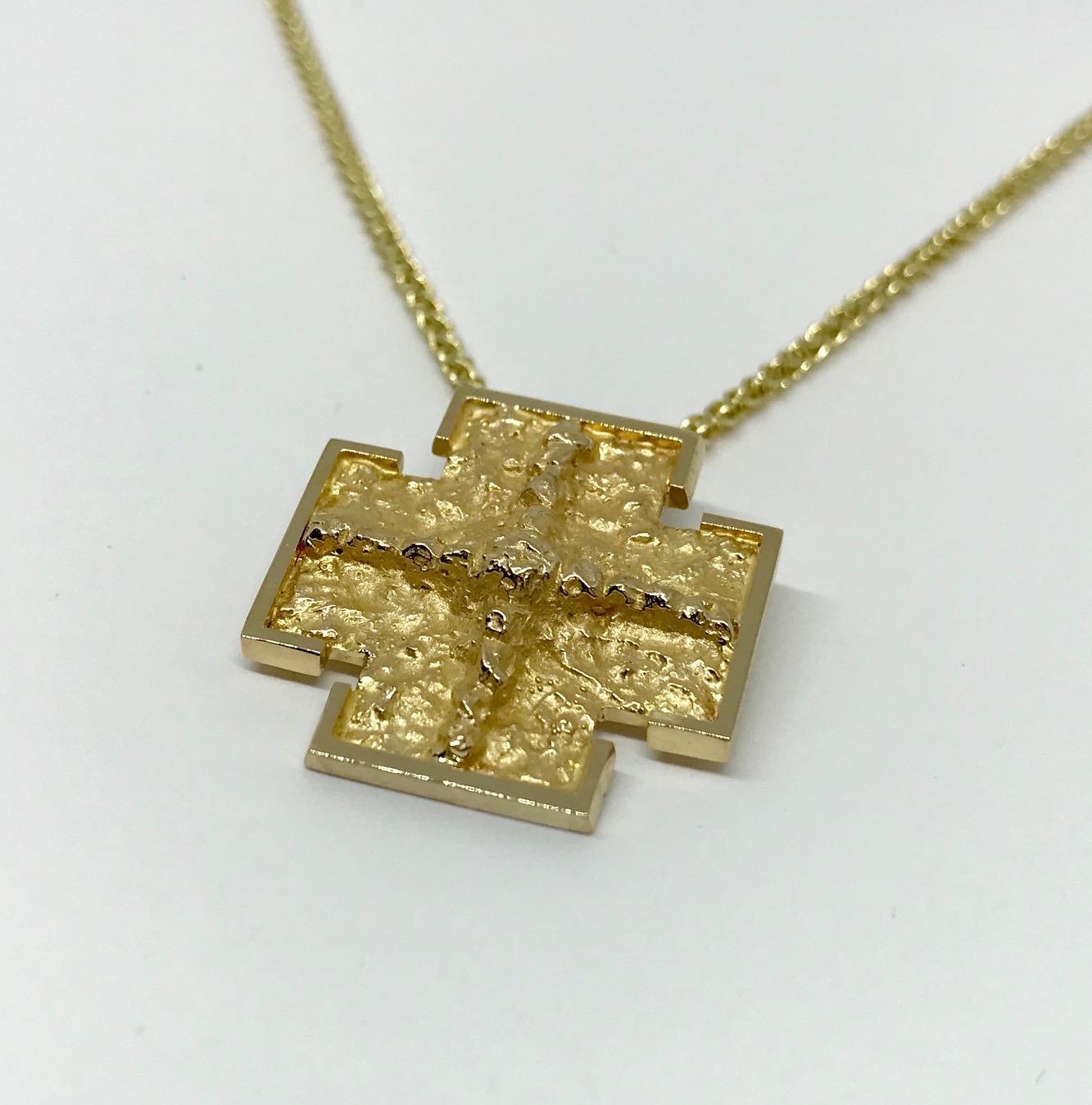 <b>Gold Cross</b><br>$ 1,022<br>14K Yellow Gold<br>Designer Series