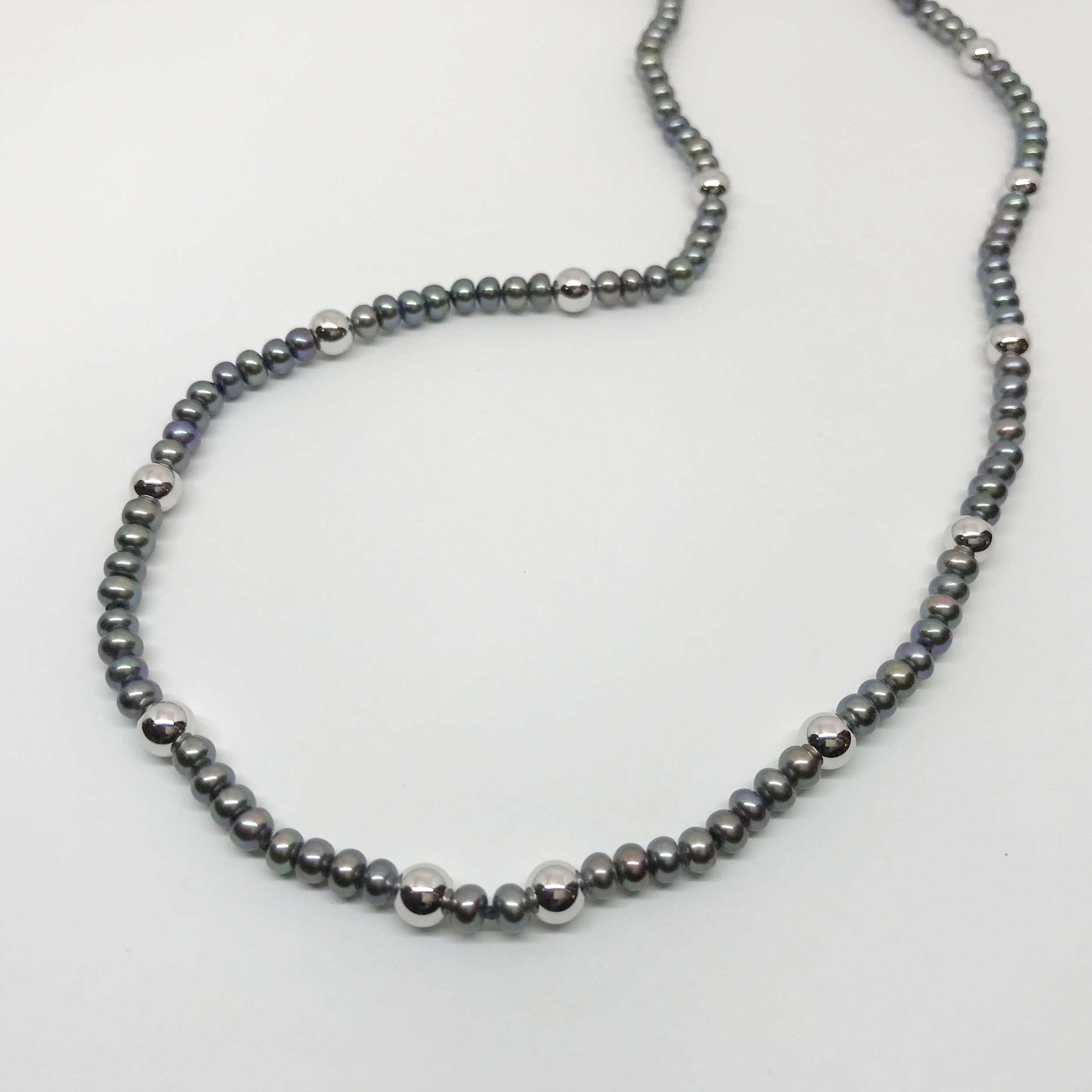 <b>Black FW Pearls w. Gold Beads</b><br>$528<br>Twelve 6mm WG Ball Beads<br>14K WG Clasp