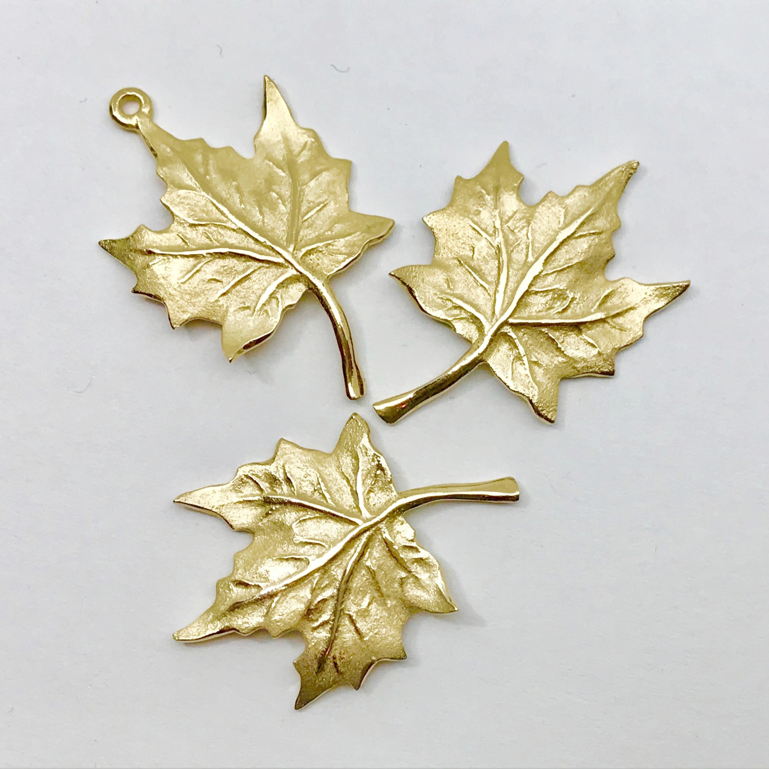 NEW IN STOCK <br><b>Maple Leaf Stick Pin</b><br>$ 570<br>14K Yellow Gold<br>Designer Series