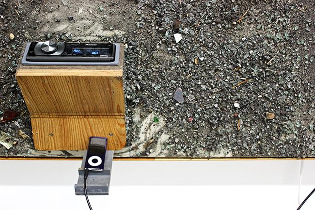 Jeff Degolier, More than Feeling, detail, 2012, autoglass, gravel, parking lot debris, car stereo on drywall