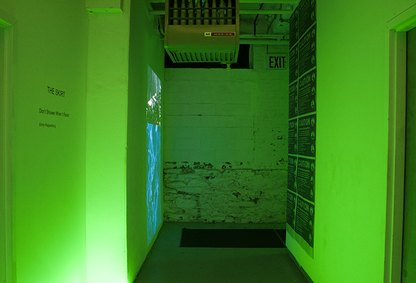 Emily Kloppenburg,  Don't Shower When It Rains , 2016, dual channel HD video projection with newsprint posters and LED lights, The Skirt, Ortega y Gasset Projects, Brooklyn