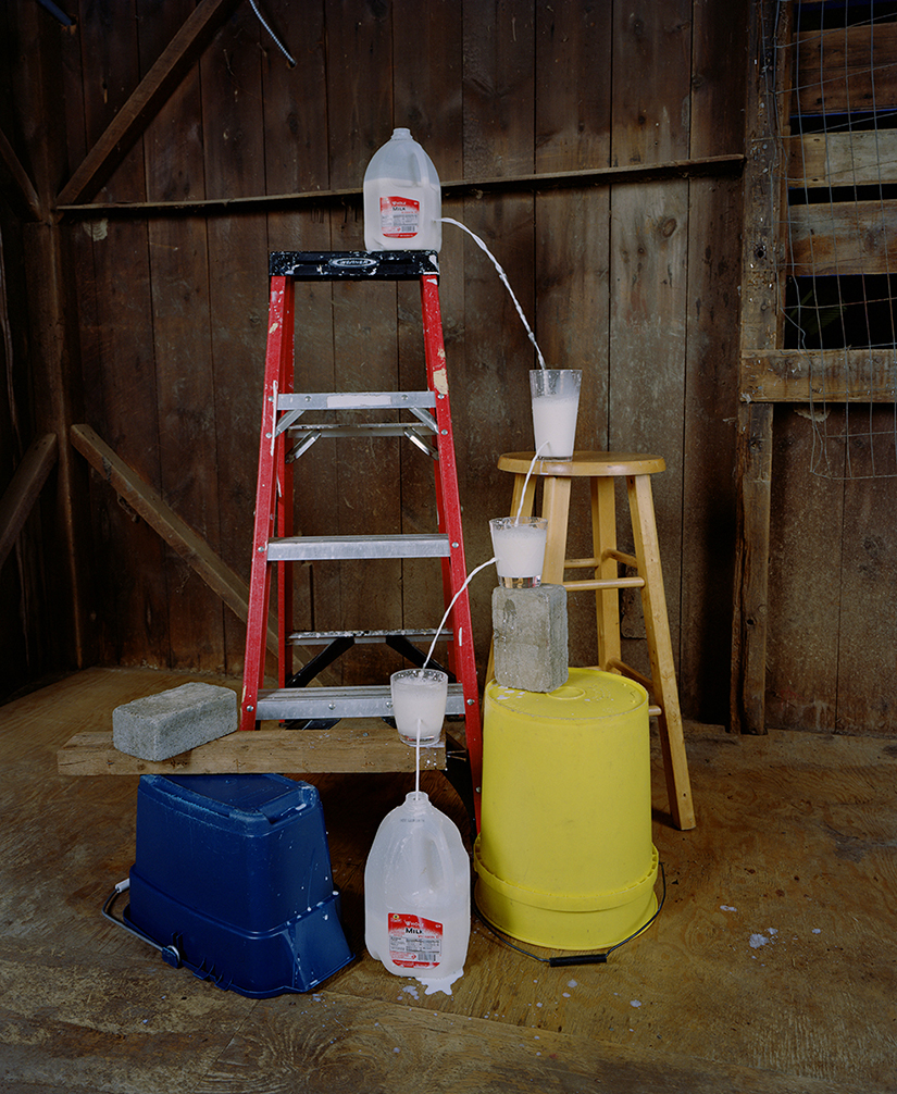 Adam Ekberg: Transferring a gallon of milk from one container to another, 2014, archival pigment print, 50 x 40 inches, Courtesy of the artist and ClampArt, New York City