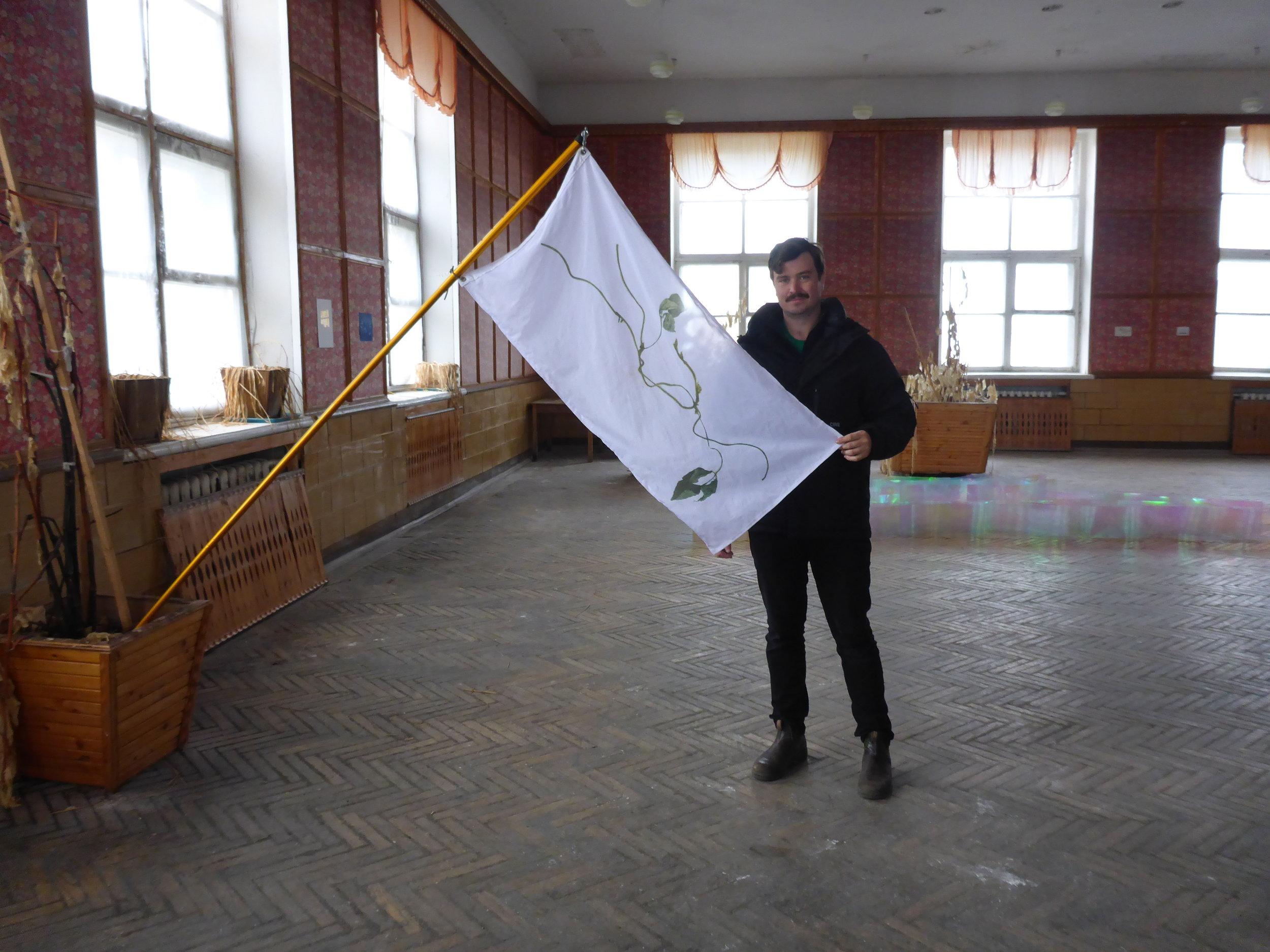 Stephan Jahanshahi, Printed nylon flag, aluminum pole, hardware,Pyramiden Canteen, Svalbard, Norway, July 2016