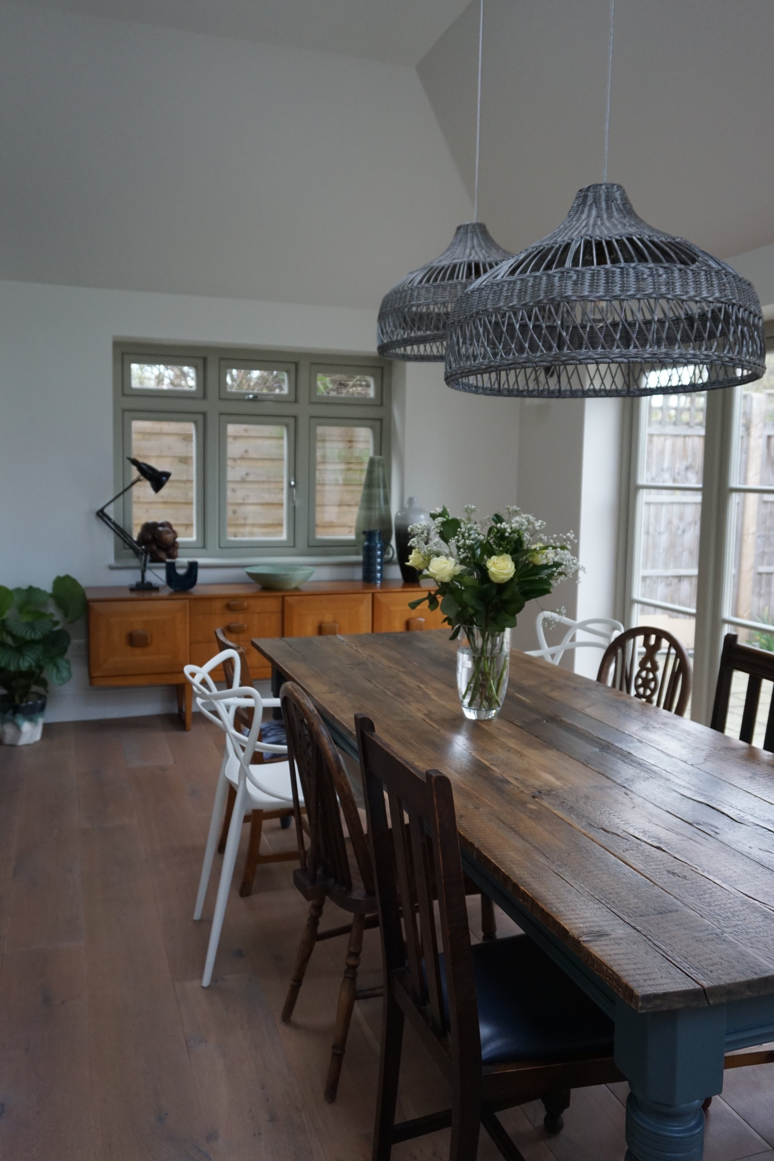 Dining space with bespoke table and mismatch chairs