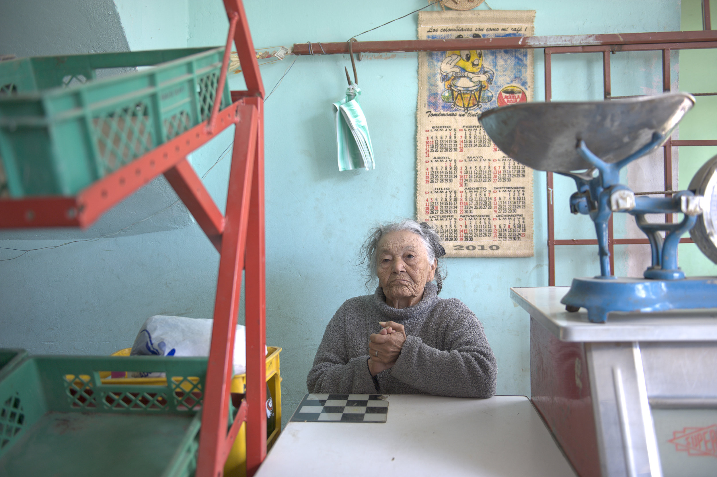 Old woman in her mini mart, Botoga, Colombia