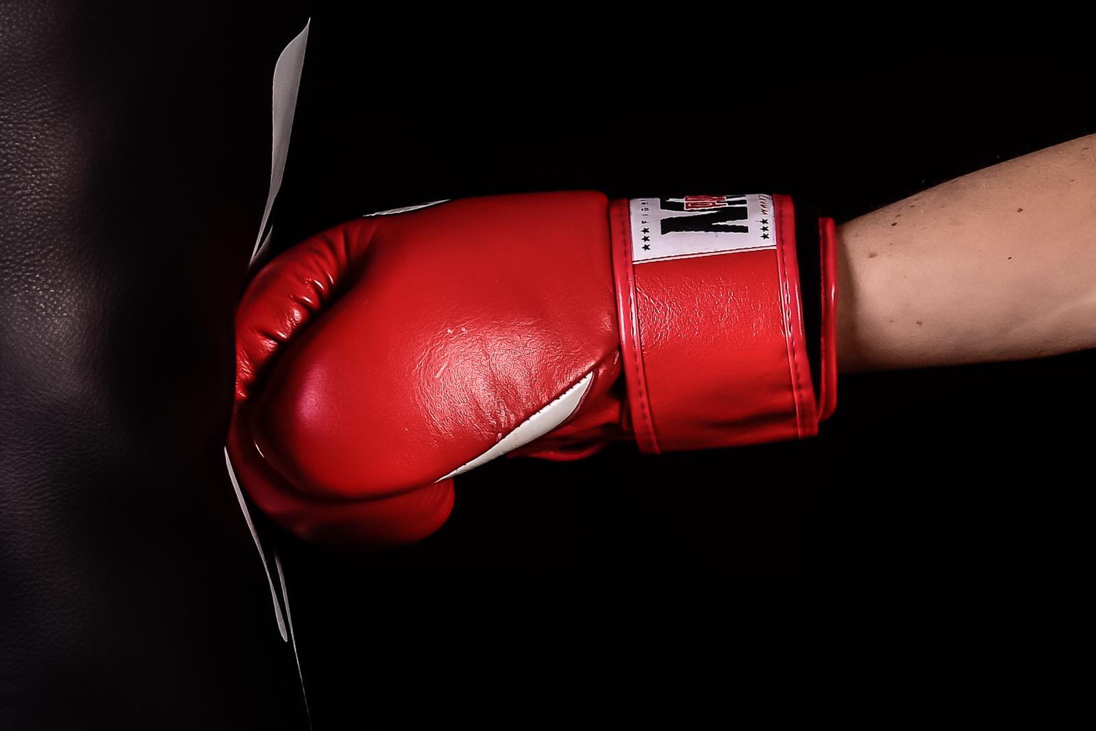 Boxing glove striking a bag - photo by David Ellard