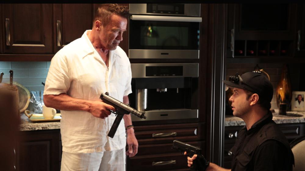 Arnold Schwarzenegger (left) some guy (right)