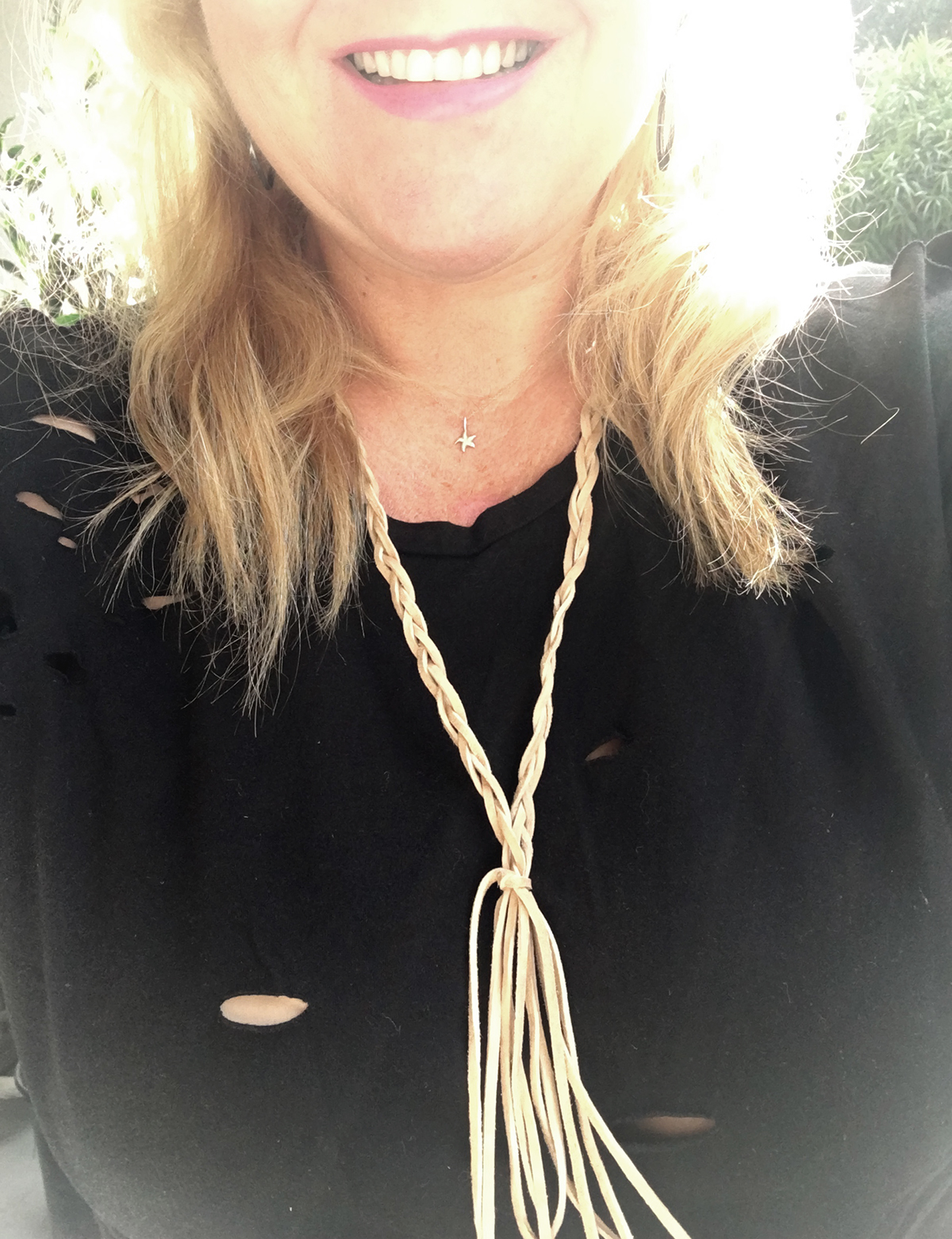 Here I am modeling my dreamcatcher necklace in light suede