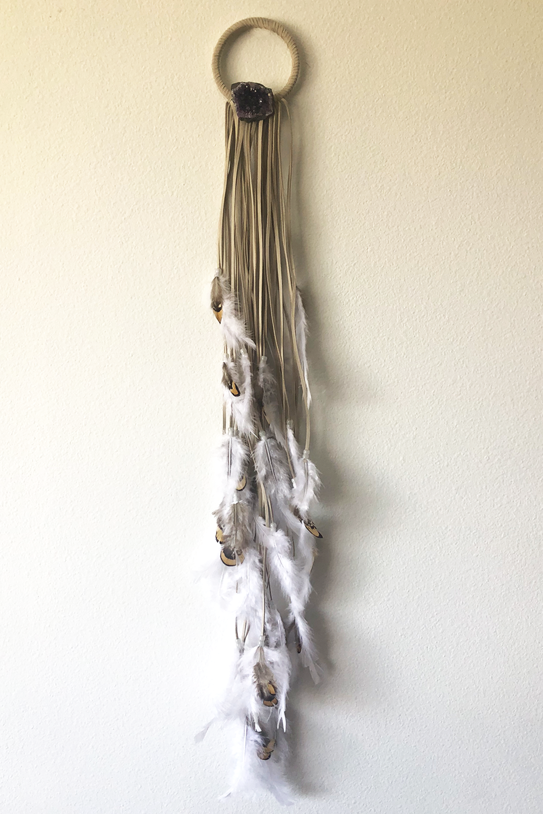 """Dreamcatcher, X-Small (4"""" diameter)  Light cord with layered white and natural colored feathers and white glow-in-the-dark beads.  Stones: Amethyst"""