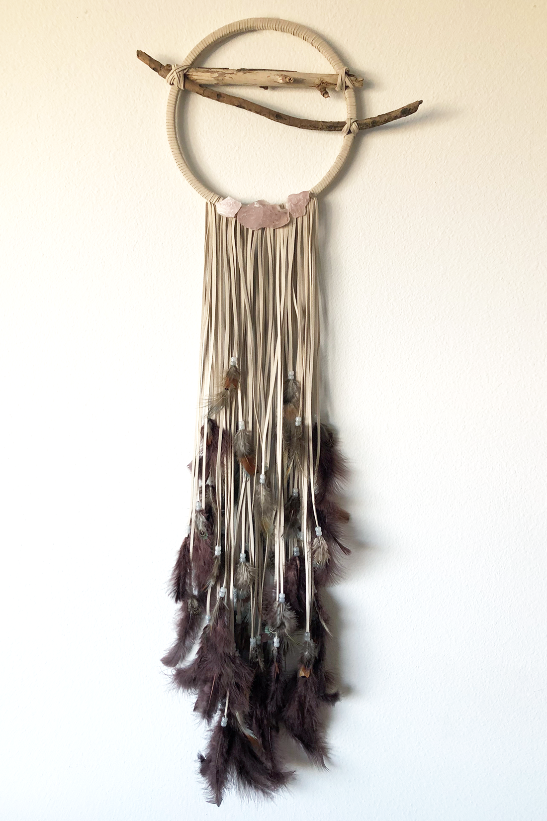 "Dreamcatcher, Medium (10"" diameter)  Light faux suede cord with layered wine colored and brown feathers.  Stones: Rose Quartz"