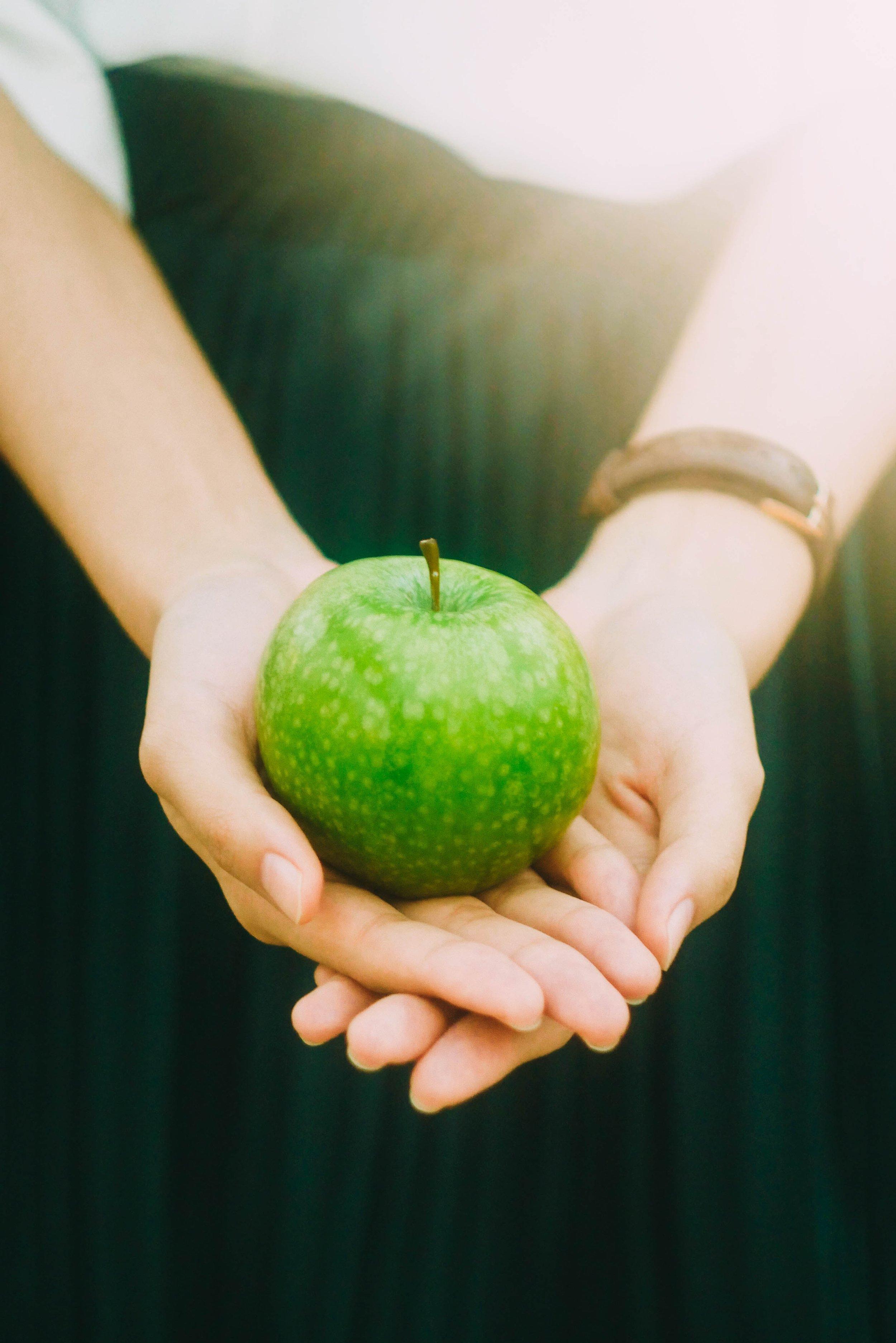holding apple.jpg
