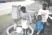 Children Filling Water from a Water Meter