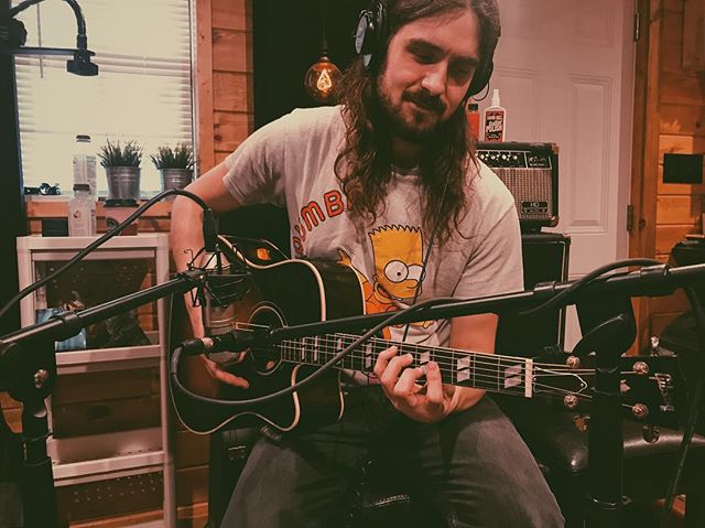 Lots of super cool stuff is coming in the next couple months and I am S.T.O.K.E.D.  Here's a picture of the beautiful @mikey.hancock with his gorgeous @gibsonguitar Hummingbird. (and his luscious locks that are no more. 🤭) #studio #recordingstudio #tracking #music #acousticguitar #gibson #nevermeant #hothothot