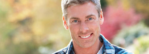 Man smiling outdoors - Cosmetic Dentistry
