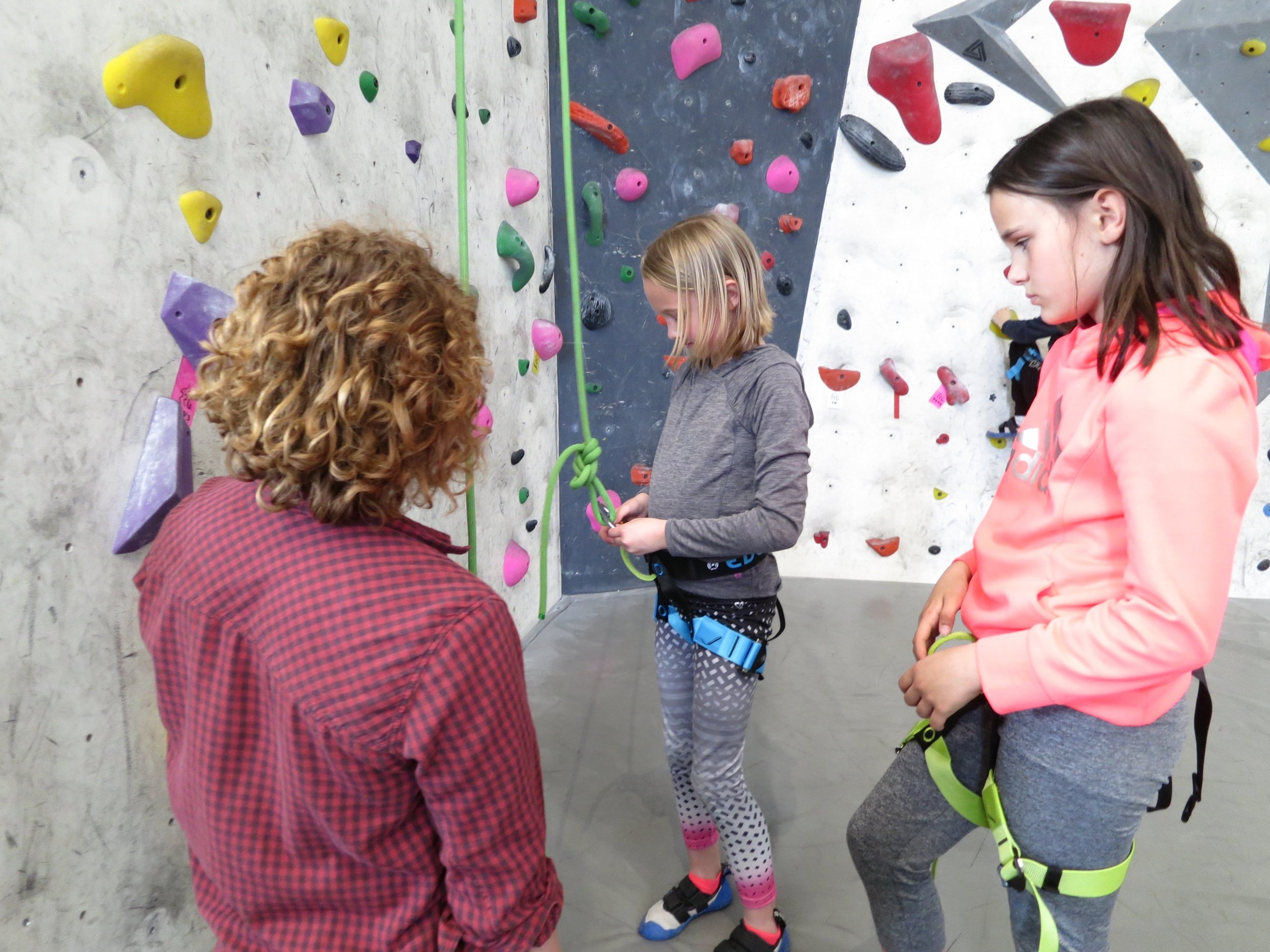 Campers learning how to tie their climbing knots during a week full of fun and learning!