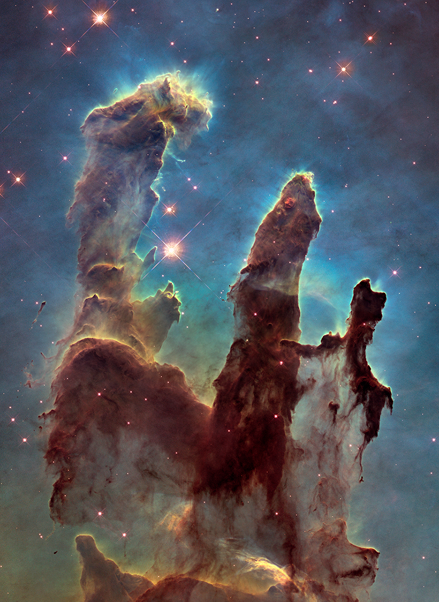 The Eagle Nebula, also known as M16, a star-forming nebula photographed by the  Hubble Space Telescope  in 2015.