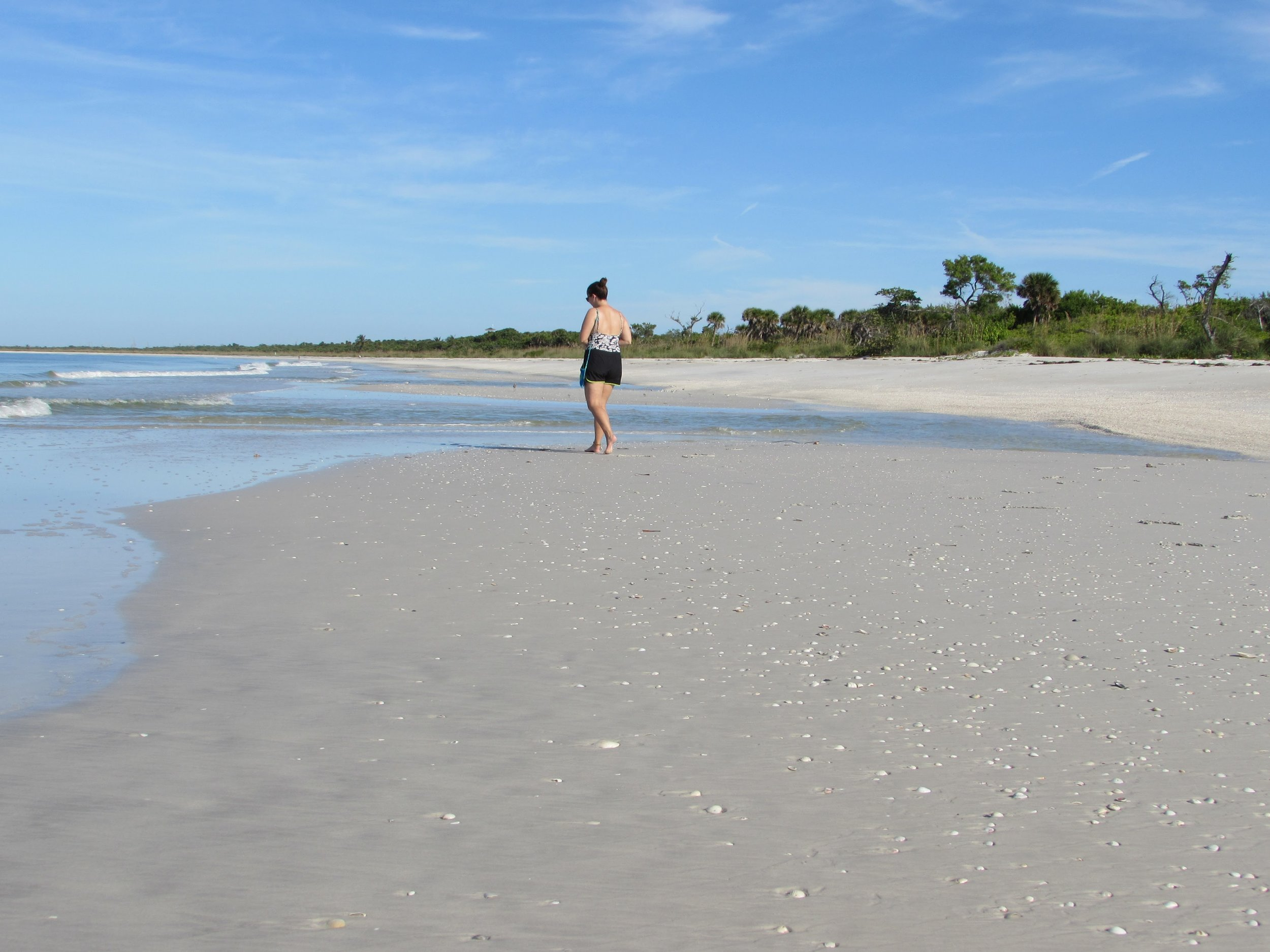 Emmett took this picture - me walking the beach at low tide in Cayo Costa State Park.