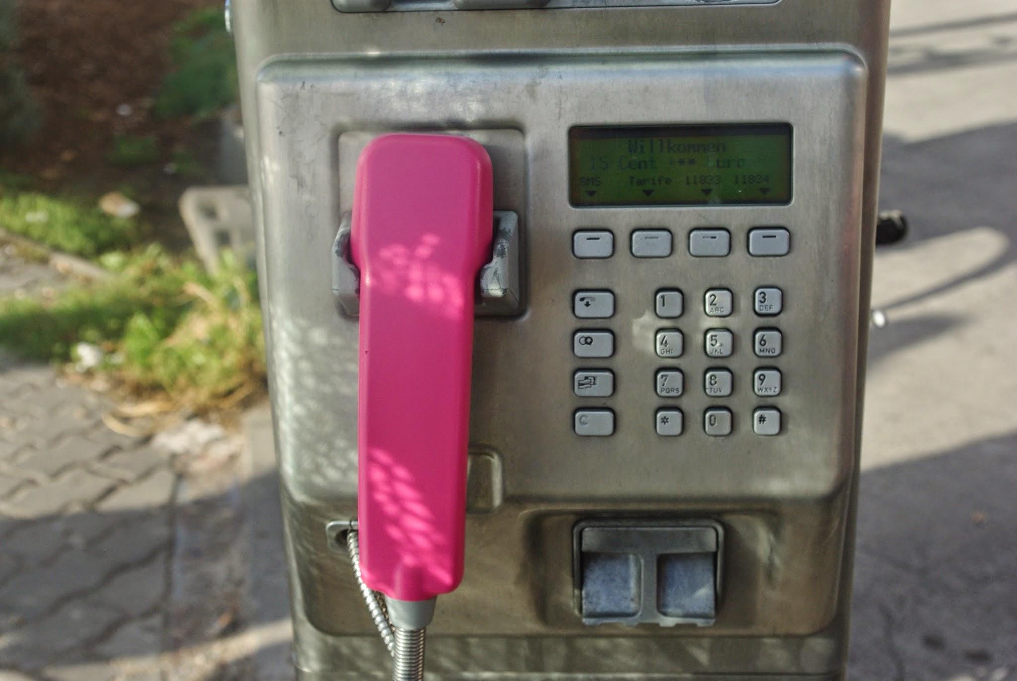 A bright pink payphone in Prenzlauer Berg, Berlin.