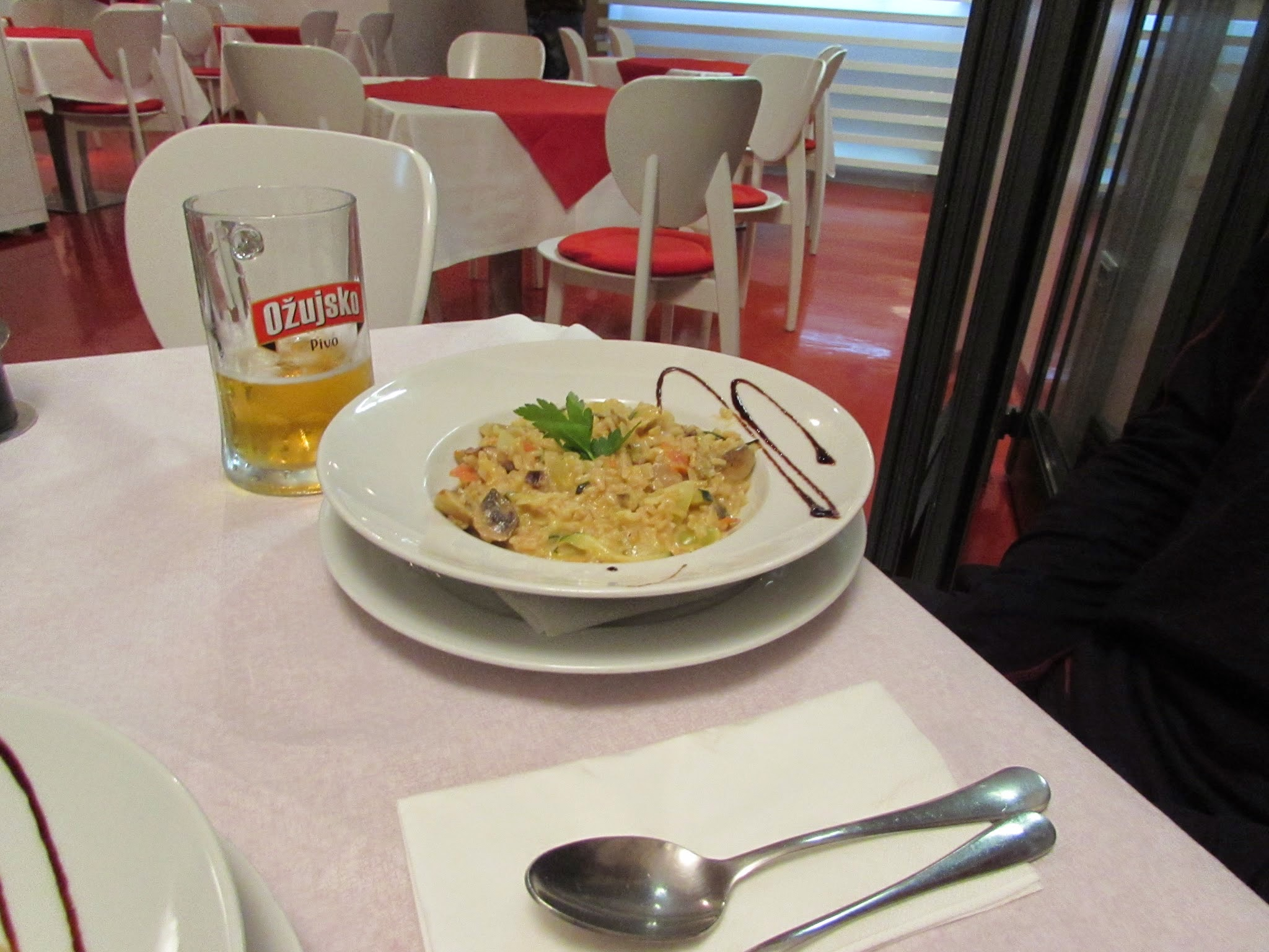 At the same restaraunt (in Fazana, north of Pula) Emmett got a carrot, onion, pepper, & mushroom risotto with some inexpensive Croatian beer.