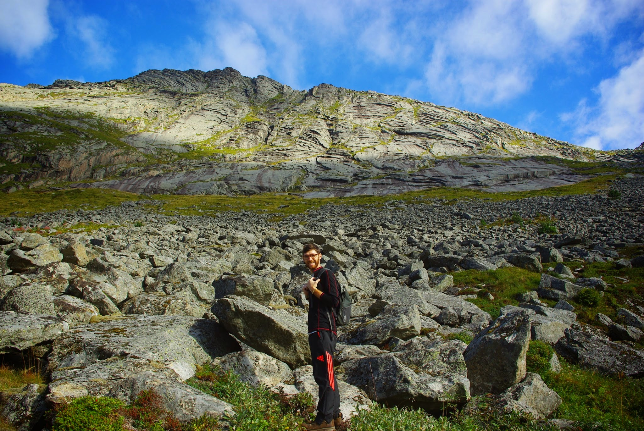 Early on in the Helvetsetind hike, there's a scree field to scramble across.