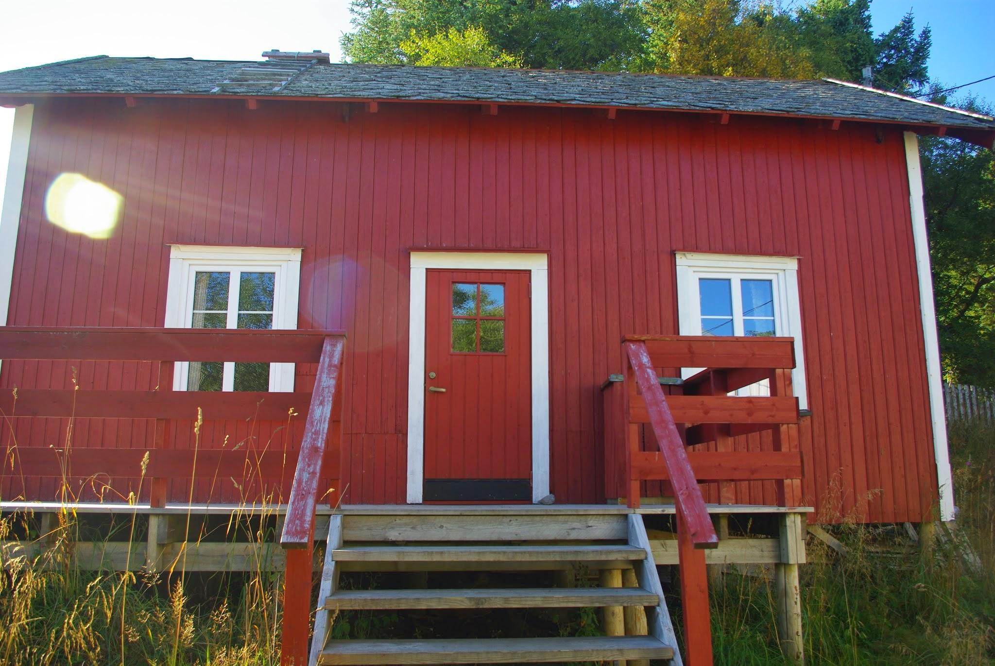 Our hostel digs in Å. Classic Scandinavian red rectangular cabin.