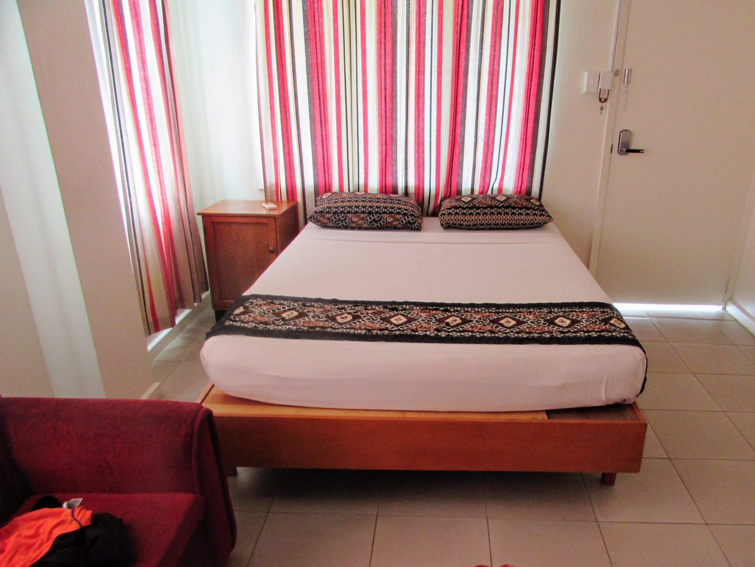 Our bed in Nadi which only looked perfectly innocent and otherwise clean.   Lies.