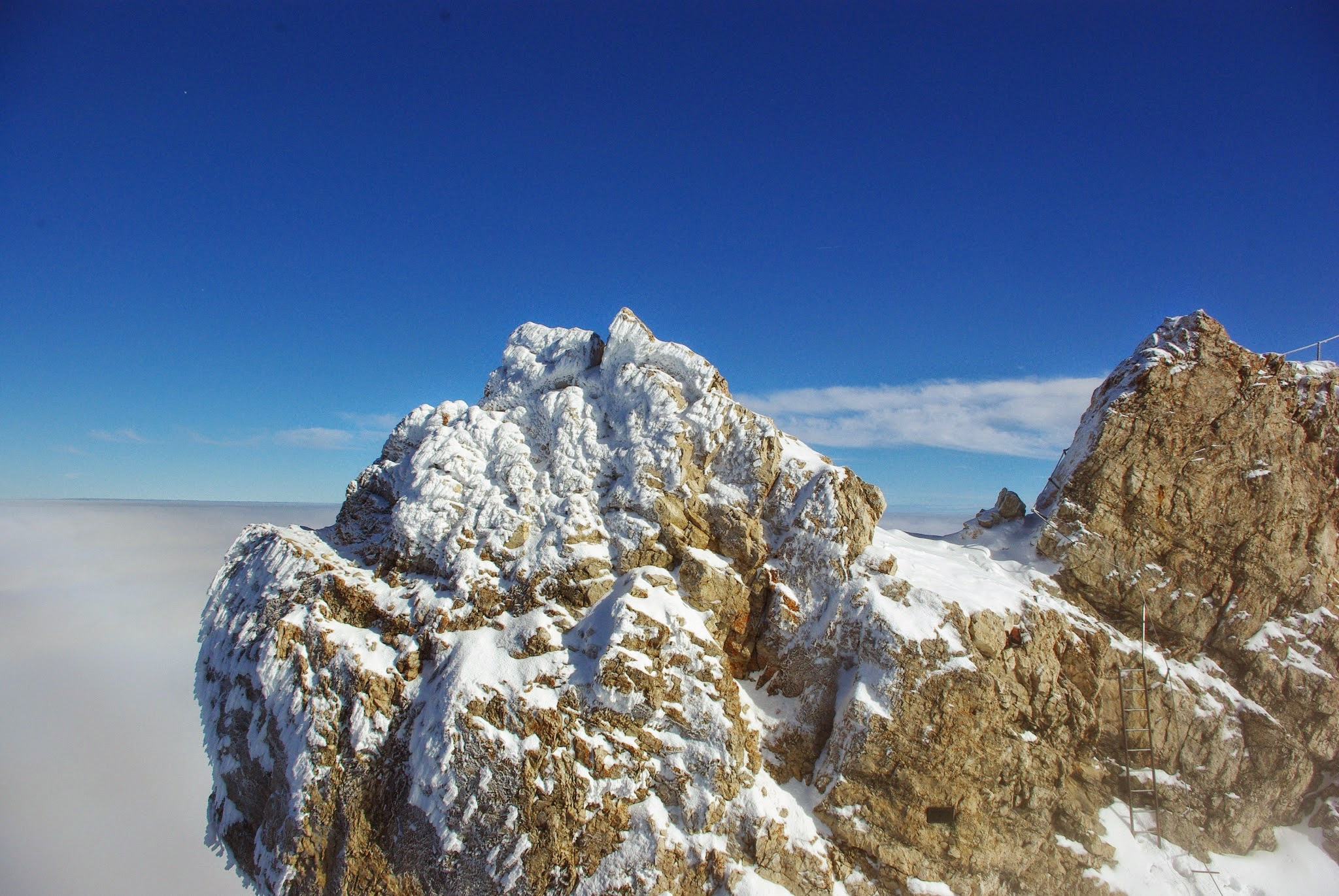 Our cable car rose out of the snow cloud and we got our first view of the snowy limestone summit.