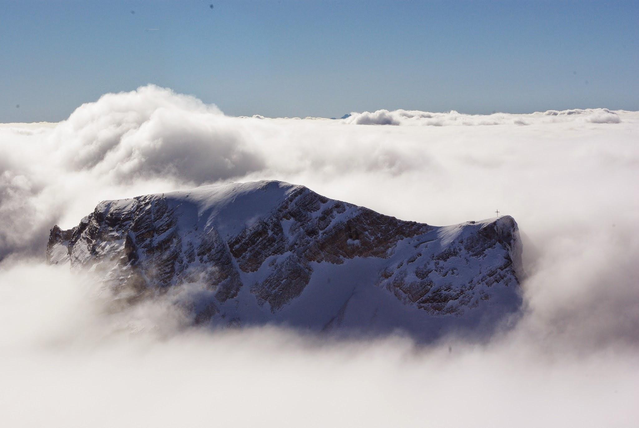 A nearby peak that  peek ed through the clouds.